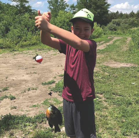 kid with fish